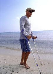 Man with crooks at beach - PE00145