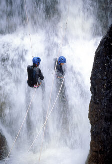 Men canyoning, rear view - 00483FF