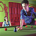 Young man and woman playing billiard - 00044ND