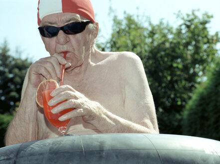 Senior man drinking juice - 00026DK