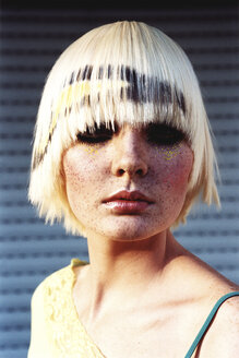 Young woman wearing blond wig, portrait - 00011DK