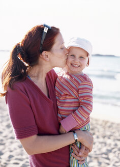 Young woman kissing child - PE00125