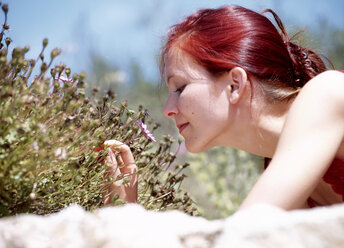 Woman smelling flowers, outdoors - 00116PE