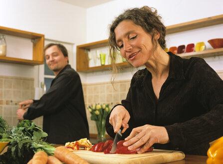 Mature couple preparing meal - PE00247
