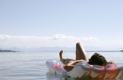 Woman on air mattress lying on front, Lake Starnberg - LDF00058