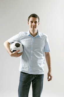 Young man holding soccer ball - LDF00030