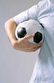 Man holding soccer ball - LDF00001