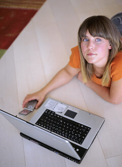 Woman with laptop and mobile phone, elevated view - DK00046