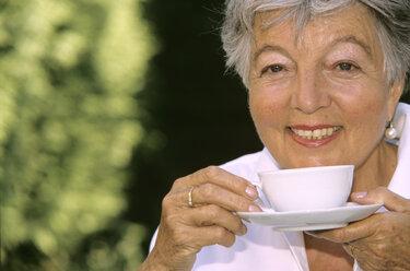 Senior woman drinking coffee, close-up - PEF00331