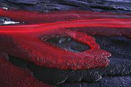 Tanzania, soda lava from Ol Doinyo Lengai volcano at dusk - RM00036