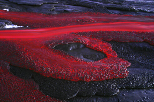 Tanzania, soda lava from Ol Doinyo Lengai volcano at dusk - RM00036