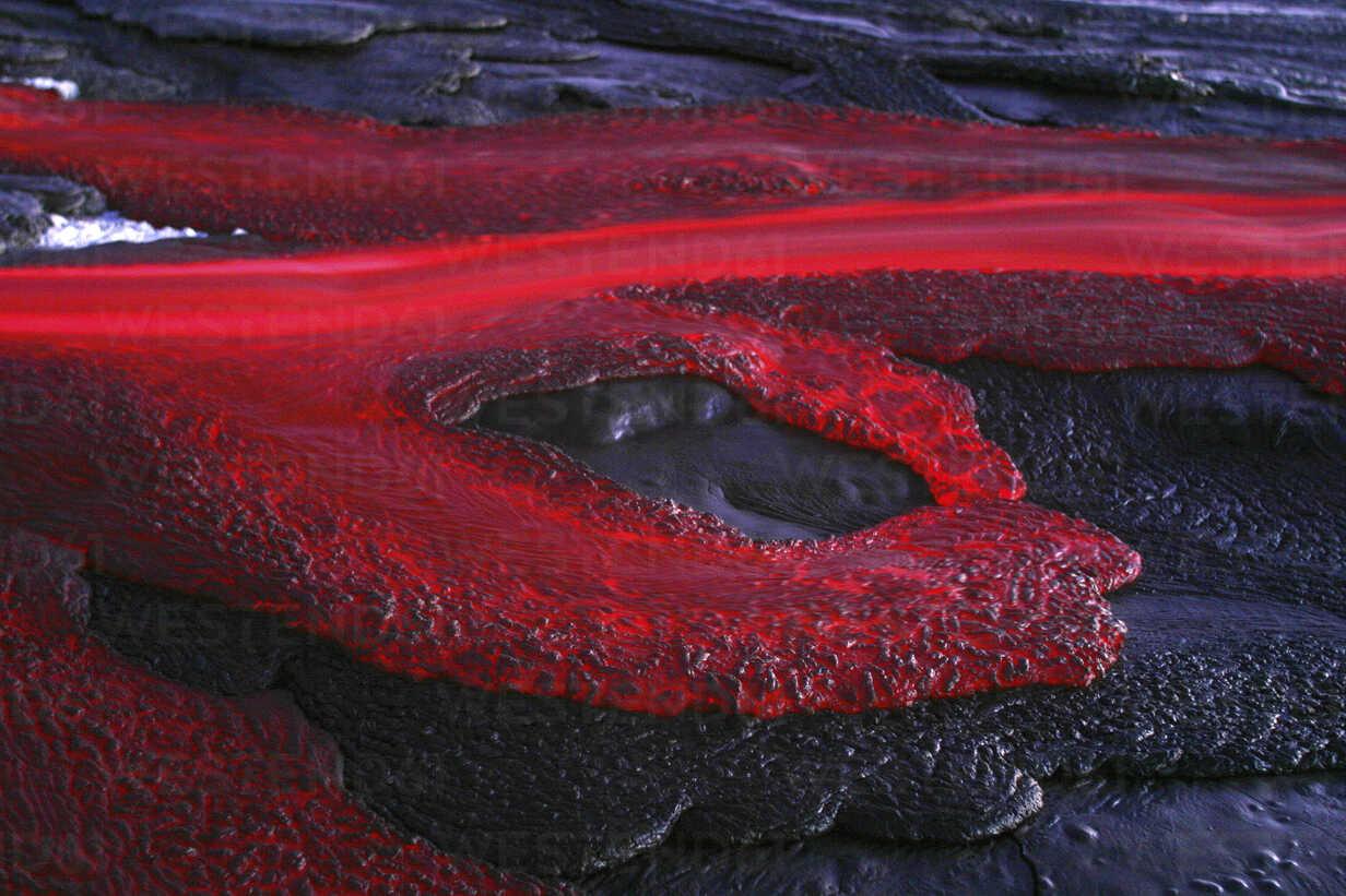 Tanzania, soda lava from Ol Doinyo Lengai volcano at dusk - RM00036 - Martin Rietze/Westend61