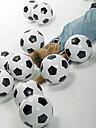Boy (10-13) lying between football - LMF00063