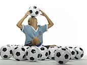 Boy (10-13) balancing football on forehead - LMF00060
