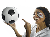 Woman with Korean flag painted on her face pointing at football, close-up - LMF00054