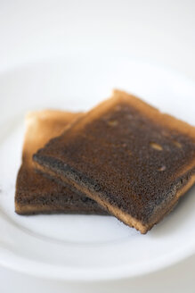 Two slices of burned toast, close-up - MNF00085