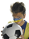 Young man with Ukrainian flag painted on face, kissing soccer ball, portrait - LMF00361