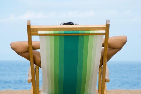Woman lying in deckchair, rear view - LDF00120