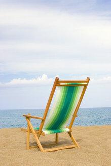 Beach chair on sand at beach, rear view - LDF00117