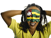 Woman with Togo flag painted on face, close-up, portrait - LMF00366