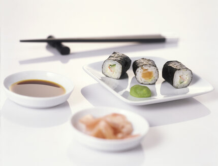 Sushi on plate with chopsticks - THF00030