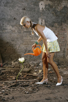 Woman watering one flower - CLF00041