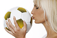 Woman kissing football - CL00017