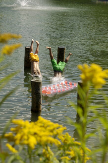 Boys jumping into lake - HHF00153