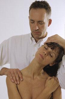 Man massaging woman - NH00084