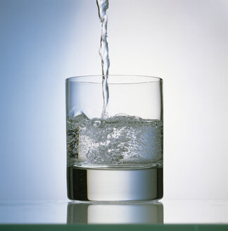 Mineral water poured in glass - MB00524