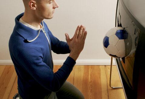 Man worshipping soccer ball - LDF00140