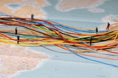 Businessmen standing between plastic wires - ASF01872