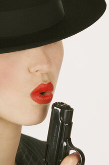Woman holding handgun - 00005LR-U