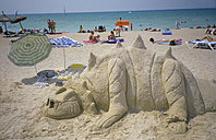 Spain, Mallorca, sand dragon with people relaxing on beach - BS00165