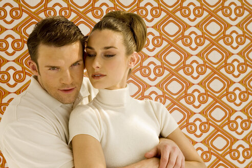 Young couple against wall paper, portrait - WESTF00329