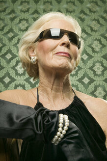 Senior woman wearing sunglasses - WEST00364