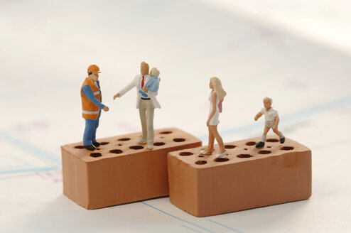 Figurines of construction workers and family at construction site - ASF02193