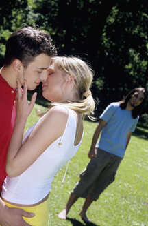 Young couple kissing, outdoors - WESTF01133