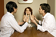 Two men looking at women shutting ears - CLF00176