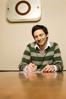 Young man writing letter - CLF00151