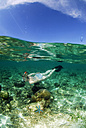 Philippines, Dalmakya Island, woman snorkelling in sea, underwater view - GNF00785