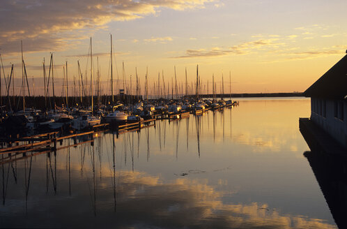 Austria, Burgenland, Boats moored at harbour, dusk - HSF00966