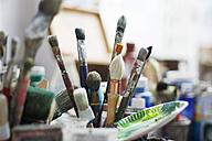 France, Paris, Brushes in artist's studio - MFF00261