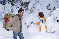 Young couple standing in snow - HHF00555