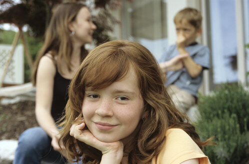 Little girl, portrait, brother and sister in background - NHF00180