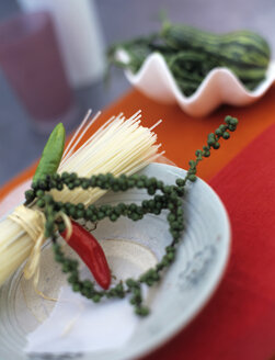 Rice noodles with green chili pepper on plate - HOE00193