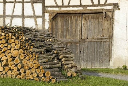 Stack of firewood in front of half-timbered house - SHF00096