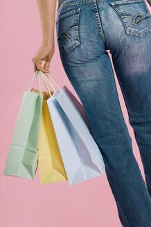 Woman carrying shopping bags, close-up - 00114LR-U