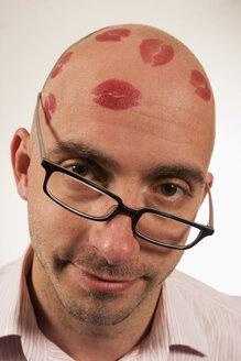 Man with lipstick kisses on head - LD00186