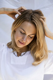 Young woman massaging her head - AB00026